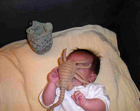 SHOCKING: Alien devouring a baby!